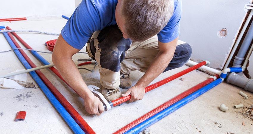 Plumber installs central heating